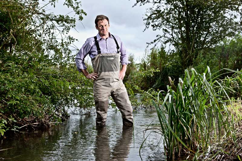 KNIGHT FRANK:  Land Agent Paddy Hoare pictured in the River Dikler at Lower Swell, Nr. Stow-on-the Wold, Gloucestershire in The Cotswolds.