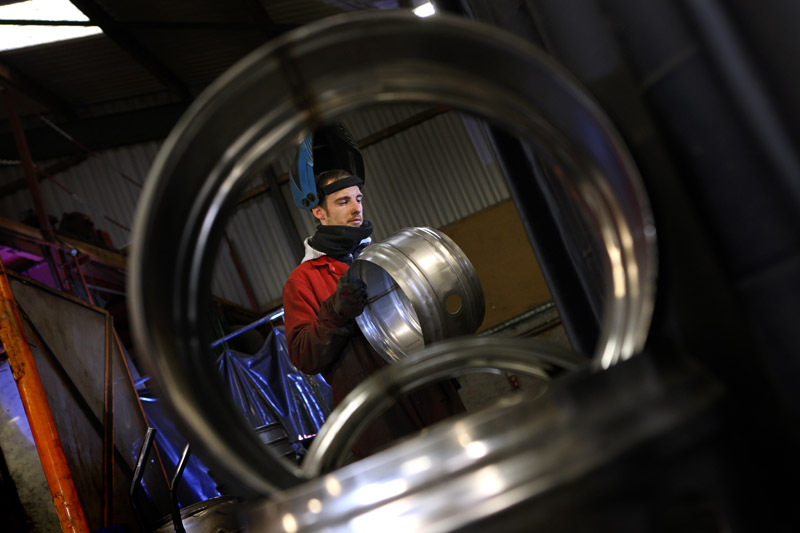 Framing the subject through a cask adds a frame within a frame.